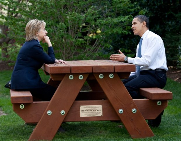 President Barack Obama and Secretary of State Hillary Rodham Clinton speak together sitting at a picnic table April 9, 2009, on the South Lawn of the White House. Official White House Photo by Pete Souza